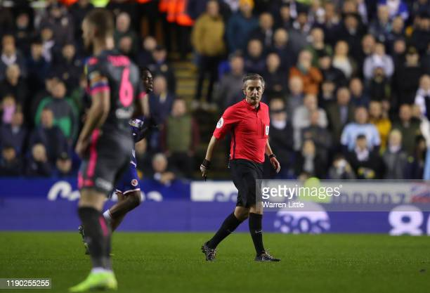 Referee D. Bond looks on during the Sky Bet Championship match between Reading and Leeds United at Madejski Stadium on November 26, 2019 in Reading,...