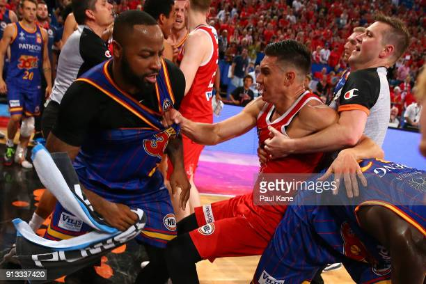 Referee Damian Lyons attempts to separate Clint Steindl of the Wildcats from Shannon Shorter of the 36ers during the round 17 NBL match between the...