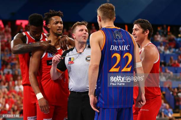 Referee Damian Lyons separates JeanPierre Tokoto of the Wildcats and Anthony Drmic of the 36ers during the round 17 NBL match between the Perth...