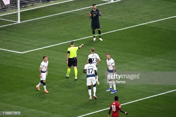 Referee Damir Skomina awards a penalty during the UEFA Champions League Final between Tottenham Hotspur and Liverpool at Estadio Wanda Metropolitano...