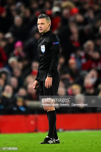 Referee Damir Skomina looks on during the UEFA Champions League Group C match between Liverpool and SSC Napoli at Anfield on December 11 2018 in...