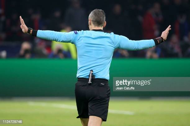 Referee Damir Skomina of Slovenia cancels a goal for Ajax after consulting the Video Assistance during the UEFA Champions League Round of 16 first...