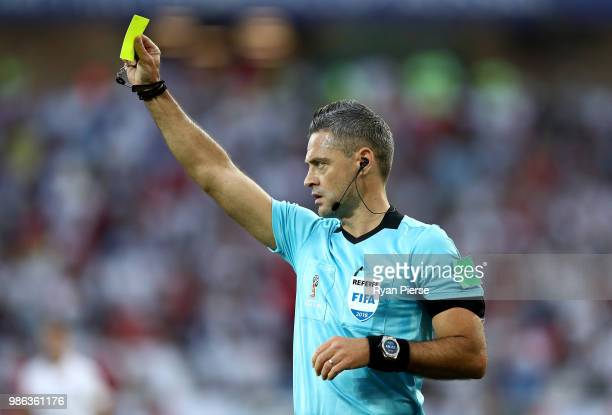 Referee Damir Skomina shows a yellow card during the 2018 FIFA World Cup Russia group G match between England and Belgium at Kaliningrad Stadium on...