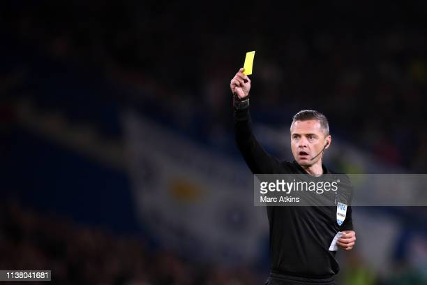 Referee Damir Skomina shows a yellow card during the UEFA Europa League Quarter Final Second Leg match between Chelsea and Slavia Praha at Stamford...