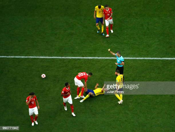 Referee Damir Skomina shows Granit Xhaka of Switzerland a yellow card during the 2018 FIFA World Cup Russia Round of 16 match between Sweden and...