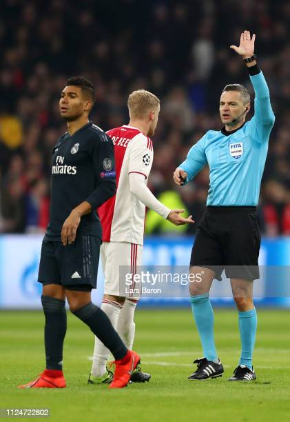 Referee Damir Skomina speaks to Donny van de Beek of Ajax about why the Ajax's goal was disallowed during the UEFA Champions League Round of 16 First...