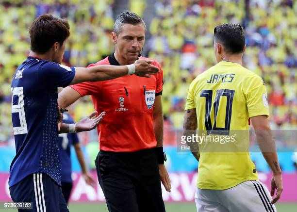Referee Damir Skomina speaks with James Rodriguez of Colombia and Hiroki Sakai of Japan during the 2018 FIFA World Cup Russia group H match between...