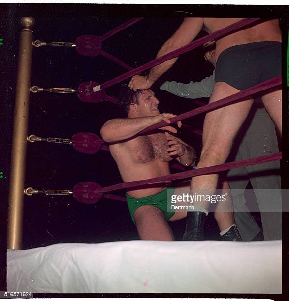 Referee Dan Bartfield tries to stop action as Michele Scicluma, of Malta, throttles strong-boy Bruno Sammartino, of Abruzzi, Italy, during their...
