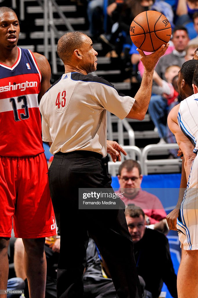 Referee Dan Crawford #43 prepares to toss a jump-ball during a game between the Washington Wizards and Orlando Magic on December 19, 2012 at Amway Center in Orlando, Florida.