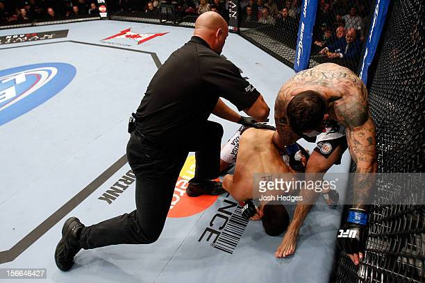 Referee Dan Miragliotta calls the fight after Alessio Sakara punched Patrick Cote in the back of the head multiple times during their middleweight...
