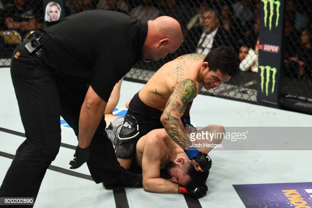 Referee Dan Miragliotta monitors Diego Ferreira of Brazil as he punches Diego Ferreira of Brazil in their lightweight bout during the UFC Fight Night...