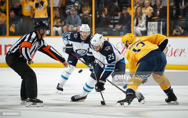 Referee Dan O'Halloran drops the puck between Nick Bonino of the Nashville Predators and Paul Stastny of the Winnipeg Jets in Game Seven of the...