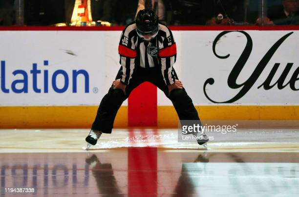 Referee Dan O'Halloran prepares for the start of an NHL game between the Philadelphia Flyers and the Ottawa Senators on December 7 2019 at the Wells...