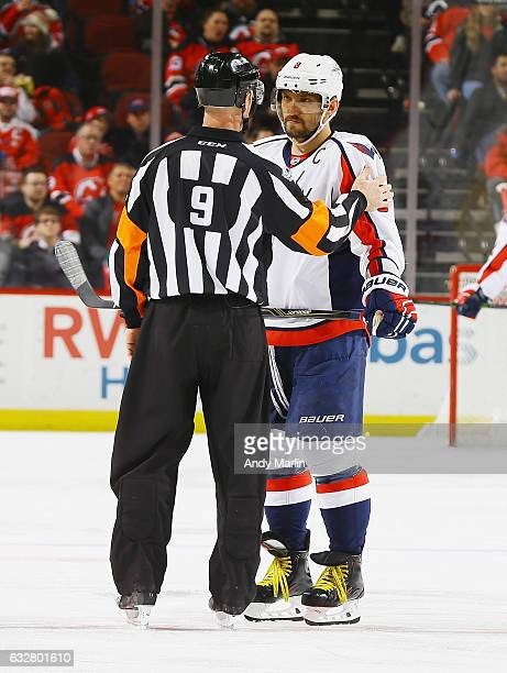Referee Dan O'Rourke talks to Alex Ovechkin of the Washington Capitals during the game against the New Jersey Devils at Prudential Center on January...