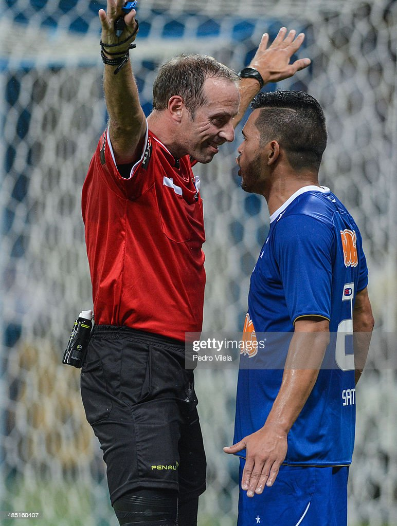 Referee Daniel Fedorczuk and Samudio of Cruzeiro during the match between Cruzeiro v Cerro Porteno for the Copa Briedgestone Liberators 2014 at Mineirao stadium on april 16, 2014 in Belo Horizonte, Brazil.