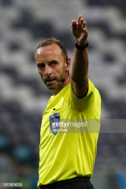 Referee Daniel Fedorczuk gestures during a match between Gremio and Lanus as part of group H of Copa CONMEBOL Sudamericana 2021 at Arena do Gremio on...