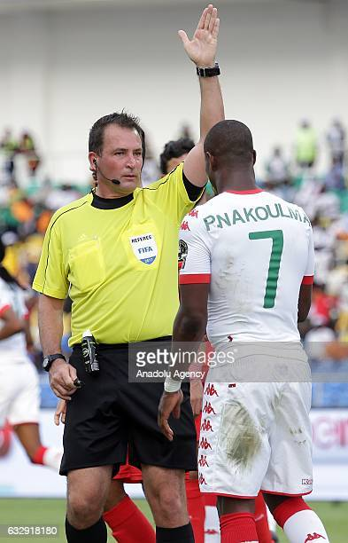 Referee Daniel Frazer Bennett gestures during the 2017 Africa Cup of Nations quarterfinal football match between Burkina Faso and Tunisia at the...