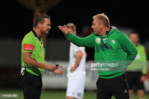 Referee Daniel Muckenhammer and Head coach Thomas Silberberger of Wattens speak during the UNIQA OeFB Cup match between TSV Hartberg and WSG Wattens...