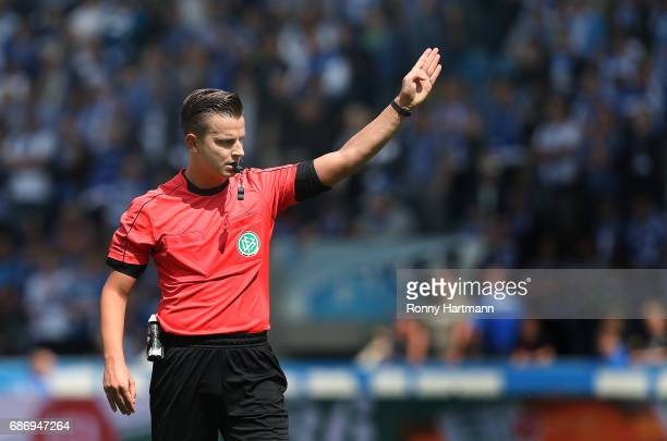 Referee Daniel Schlager gestures during the Third League match between 1 FC Magdeburg and Sportfreunde Lotte at MDCCArena on May 20 2017 in Magdeburg...