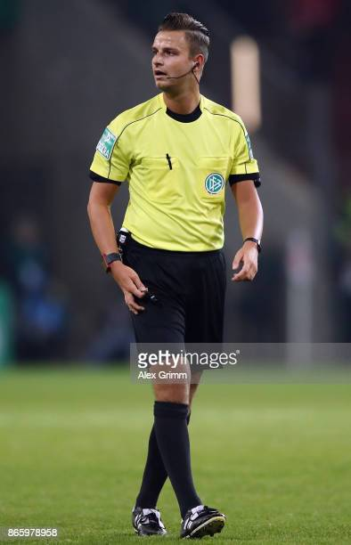 Referee Daniel Schlager reacts during the DFB Cup match between 1 FSV Mainz 05 and Holstein Kiel at Opel Arena on October 24 2017 in Mainz Germany