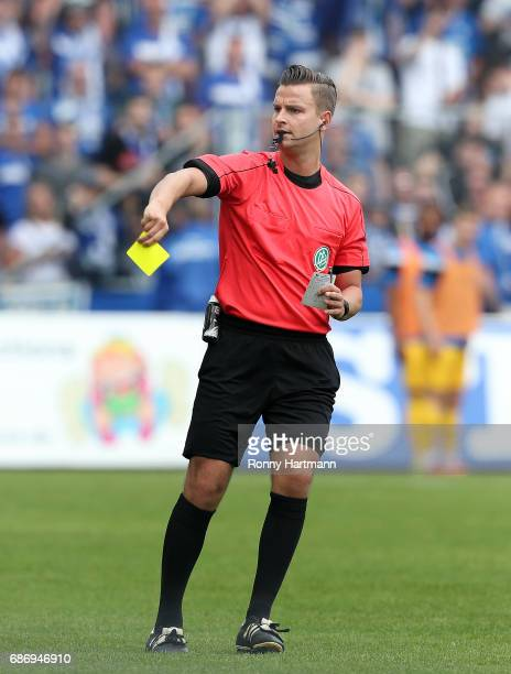 Referee Daniel Schlager shows a yellow card during the Third League match between 1 FC Magdeburg and Sportfreunde Lotte at MDCCArena on May 20 2017...