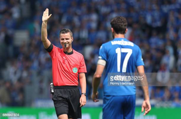 Referee Daniel Schlager smiles next to Marius Sowislo of Magdeburg during the Third League match between 1 FC Magdeburg and Sportfreunde Lotte at...