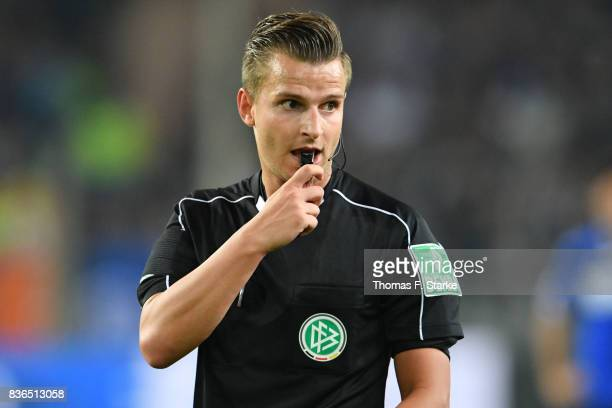 Referee Daniel Schlager whistler during the Second Bundesliga match between DSC Arminia Bielefeld and VfL Bochum 1848 at Schueco Arena on August 21...