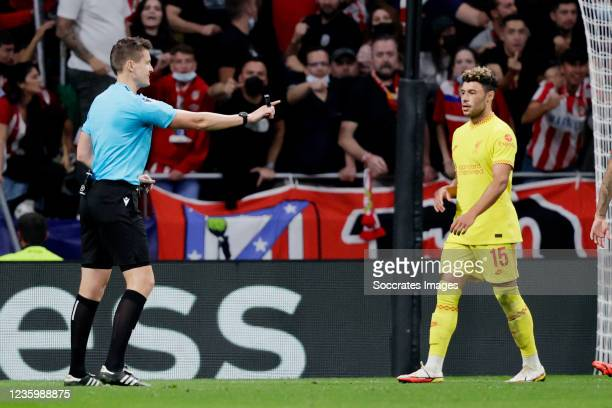Referee Daniel Siebert Alex Oxlade Chamberlain of Liverpool FC during the UEFA Champions League match between Atletico Madrid v Liverpool at the...