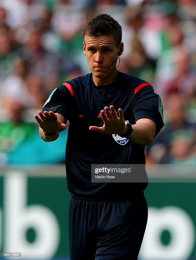 Referee Daniel Siebert gestures during the Bundesliga match between SV Werder Bremen and Schalke 04 at Weserstadion on August 15, 2015 in Bremen, Germany.