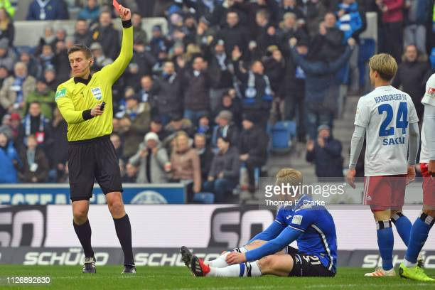 Referee Daniel Siebert shows the red card to Gotoku Sakai of Hamburg who tackled Andreas Voglsammer of Bielefeld during the Second Bundesliga match...