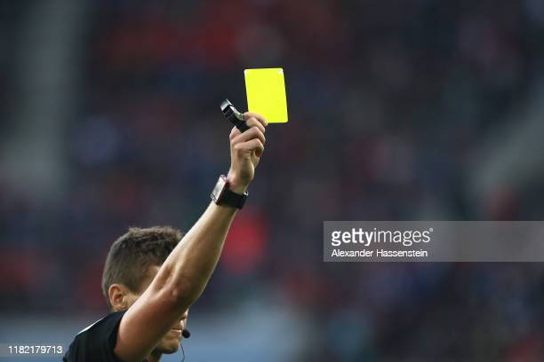 Referee Daniel Siebert shows the Yellow Card during the Bundesliga match between FC Augsburg and FC Bayern Muenchen at WWKArena on October 19 2019 in...
