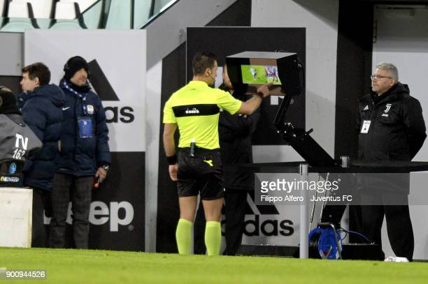 Referee Daniele Doveri checks the VAR during the TIM Cup match between Juventus and Torino FC at Allianz Stadium on January 3 20
