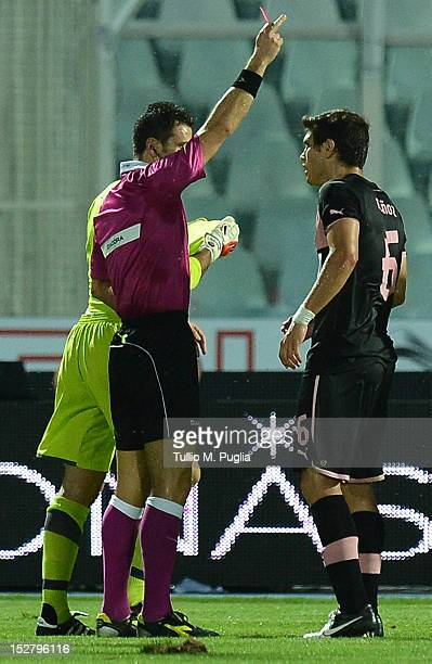Referee Daniele Doveri issues a red card to Steve Von Bergen of Palermo during the Serie A match between Pescara and US Citta di Palermo at Adriatico...