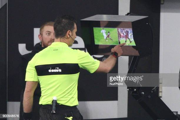 Referee Daniele Doveri watch at the Var during the Coppa Italia quarter finals football match JUVENTUS TORINO on at the Allianz Stadium in Turin Italy