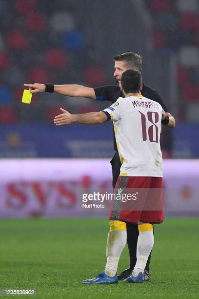 Referee Daniele Orsato and Henrikh Mkhitaryan during the FIFA World Cup Qatar 2022 qualification Group J football match between Romania and Armenia...