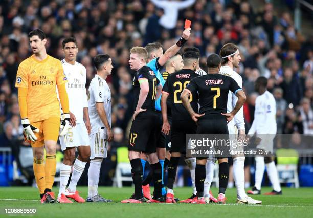 Referee Daniele Orsato awards Sergio Ramos of Real Madrid a red card during the UEFA Champions League round of 16 first leg match between Real Madrid...