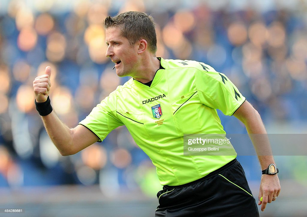 Referee Daniele Orsato gestures during the Serie A match between AS Roma and ACF Fiorentina at Stadio Olimpico on December 8, 2013 in Rome, Italy.