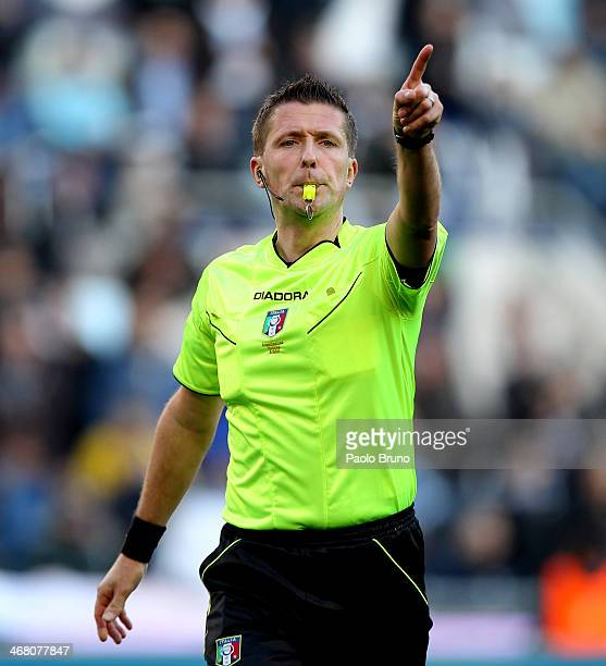Referee Daniele Orsato gestures during the Serie A match between SS Lazio and AS Roma at Stadio Olimpico on February 9 2014 in Rome Italy