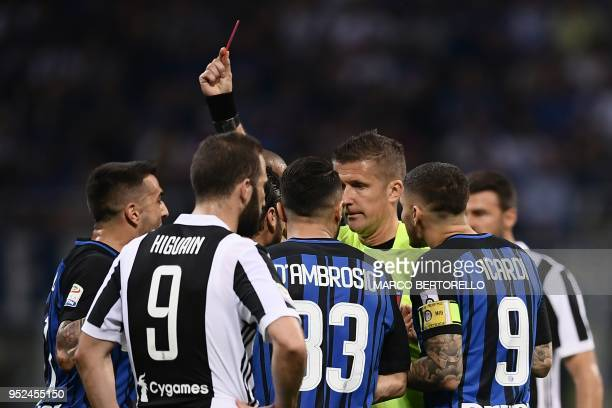 Referee Daniele Orsato gives a red card to Inter Milan's midfielder Matias Vecino from Uruguay during the Italian Serie A football match Inter Milan...