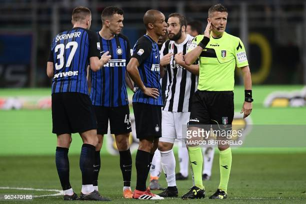 Referee Daniele Orsato listens to his colleagues from Var and not validates the score of Juventus' French midfielder Blaise Matuidi during the...