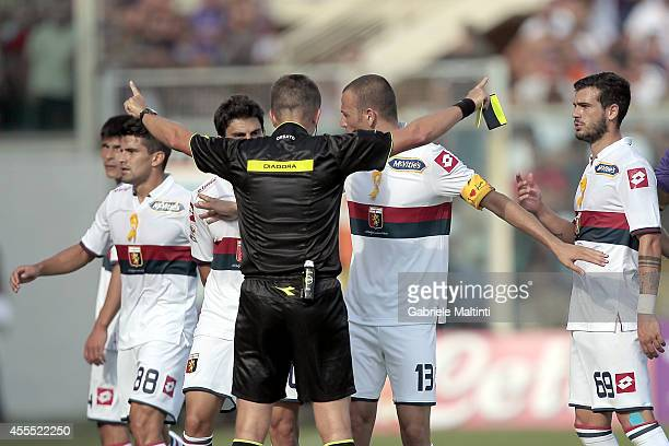 Referee Daniele Orsato of Schio has words with Genoa CFC players during the Serie A match between ACF Fiorentina and Genoa CFC at Stadio Artemio...