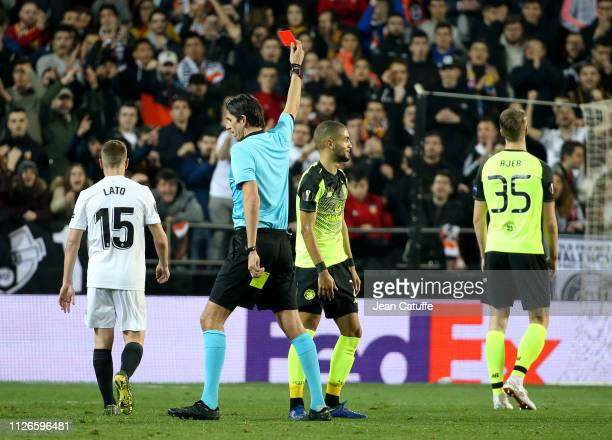Referee Daniz Aytekin of Germany gives a red card to Jeremy Toljan of Celtic during the UEFA Europa League Round of 32 Second Leg match between...