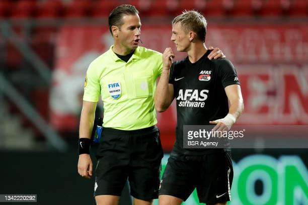 Referee Danny Makkelie and Jesper Karlsson of AZ during the Dutch Eredivisie match between FC Twente and AZ at De Grolsch Veste on September 23, 2021...