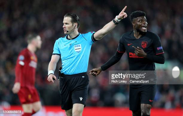 Referee Danny Makkelie gestures as Atletico Madrid's Thomas Partey reacts during the UEFA Champions League round of 16 second leg match between...