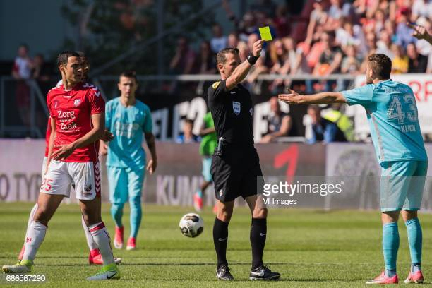 referee Danny Makkelie give Mateusz Klich of FC Twente a yellow card after a fual at Sofyan Amrabat of FC Utrecht during the Dutch Eredivisie match...
