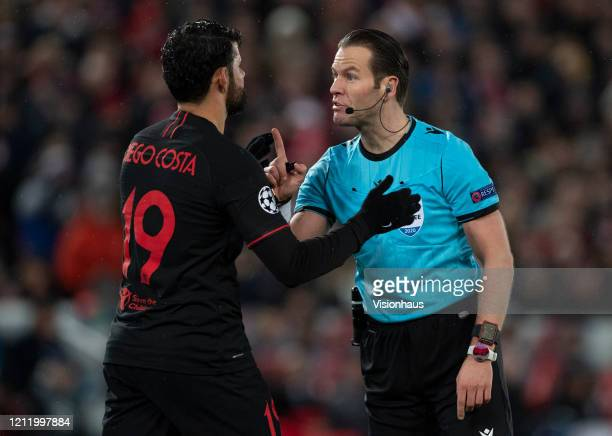 Referee Danny Makkelie makes a point to Diego Costa of Atletico Madrid during the UEFA Champions League round of 16 second leg match between...