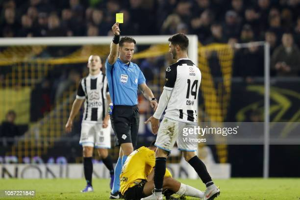 referee Danny Makkelie Mounir El Allouchi of NAC Breda Mohammed Osman of Heracles Almelo during the Dutch Eredivisie match between NAC Breda and...