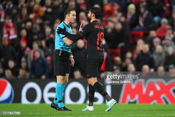 Referee Danny Makkelie speaks to Diego Costa of Atletico Madrid during the UEFA Champions League round of 16 second leg match between Liverpool FC...