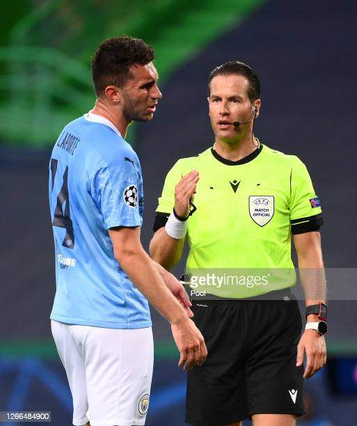 Referee Danny Makkelie speaks with Aymeric Laporte of Manchester City during the UEFA Champions League Quarter Final match between Manchester City...