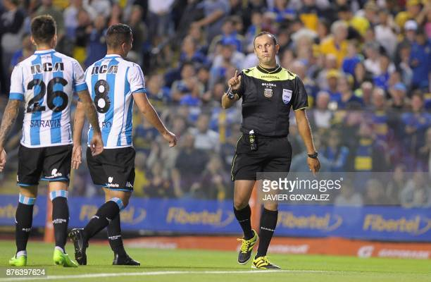 Referee Dario Herrera gestures during the Argentine match between Boca Juniors and Racing Club in the Superliga first division tournament at Alberto...